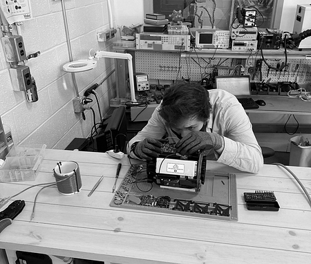 The H3x lab with someone working on a motor the size of a toaster.