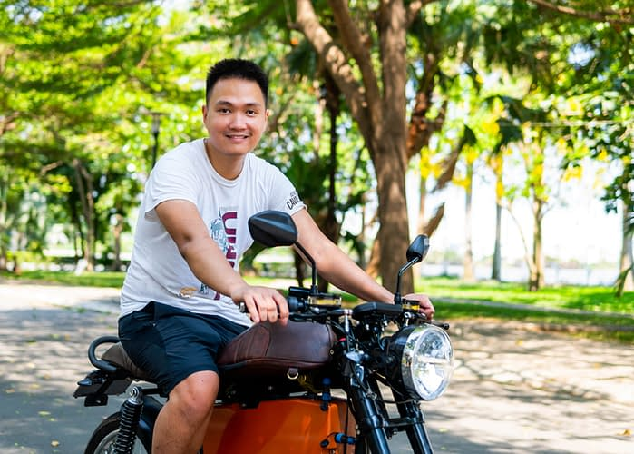 Son Nguyen, founder and chief executive officer of Dat Bike on one of the startup's motorbikes