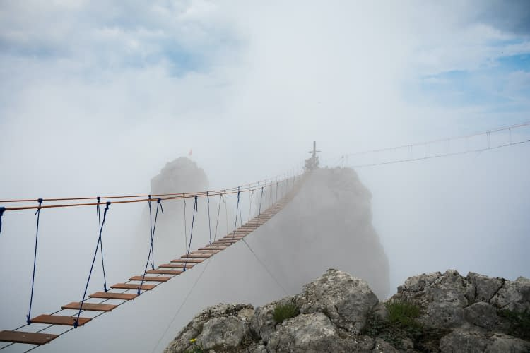Tourist route to the top of the mountain. Rope bridge in the clouds. Crimea. Ai-Petri