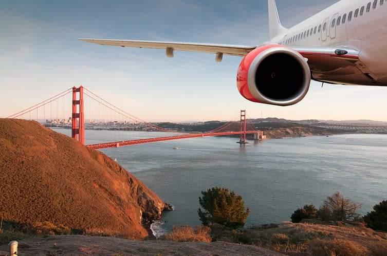 Passenger Jet Plane Flying Above San Francisco for travel concept