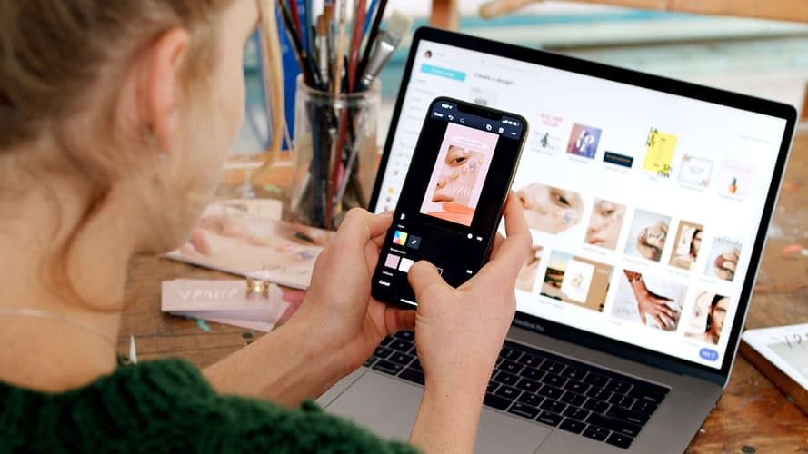 person using Canva platform on mobile phone and desktop